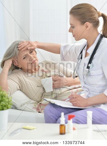 young doctor and her senior senior patient