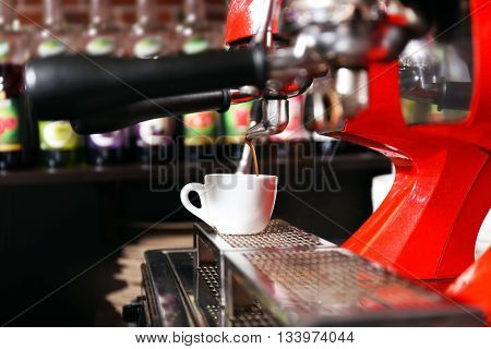 Coffee machine with cup, close-up