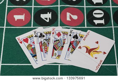 The combination of playing cards on green casino table