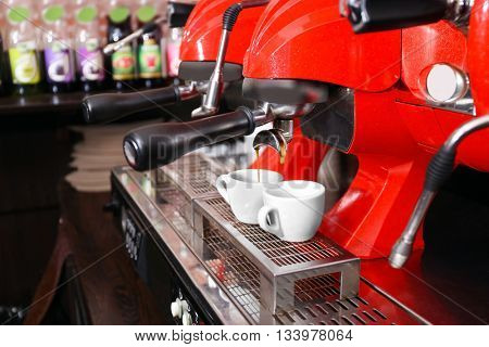Coffee machine with cups, close-up