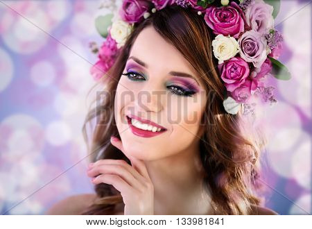 Beautiful young woman wearing floral headband on festive background