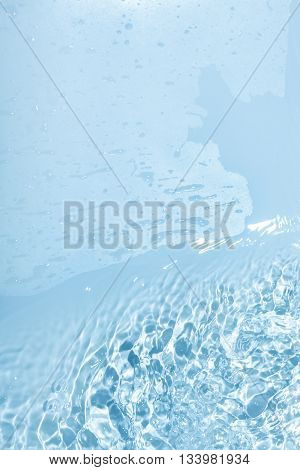 Abstract blue water background with many drops and drips