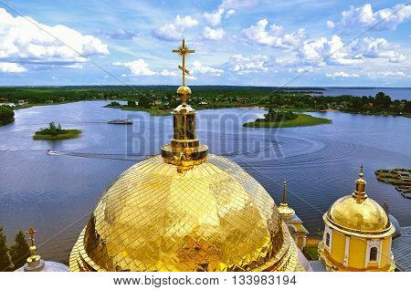 Architecture landscape - Seliger Lake from height and gold dome of the Nilo-Stolobensky Monastery on the foreground in Tver region Russia - summer architecture birds eye view