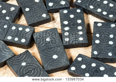 Macro photo of a group of old wooden pieces of the domino game on a wooden table