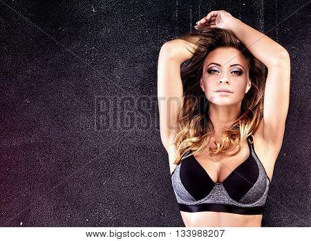 Fitness Woman Posing In Studio.