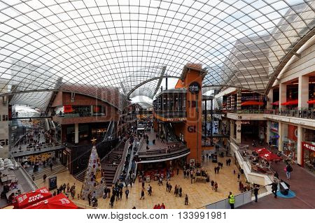 BRISTOL, ENGLAND, 7 NOV 2015.  Photograph of Cabot Circus Shopping Centre.  Close to the City Centre, the Cabot Circus development contains shops, apartments, offices, a 13 screen cinema, adventure golf and a hotel. Completed in 2008