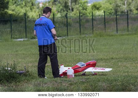 Bialystok Poland June 12 2016: boy playing with a model plane with an internal combustion engine