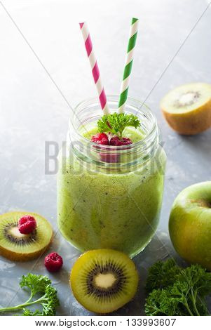 Green smoothie. Smoothie from apple spinach and kiwi in a mason jar.