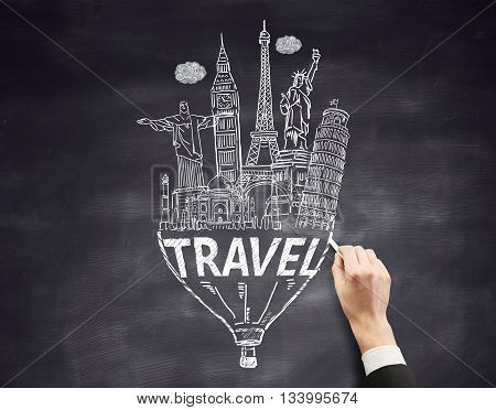 Travel concept with businessman hand drawing sketch on chalkboard background