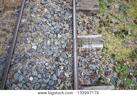 Old narrow-gauge railways detail with small rocks from above
