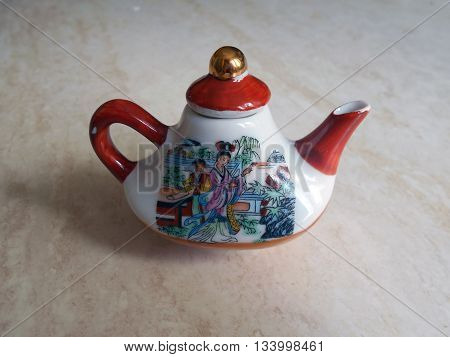 Chinese porcelain teapot. On the teapot scene of the life of the ancient Chinese.