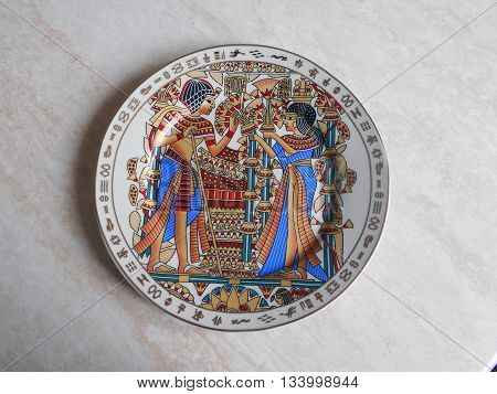 Egyptian dish. At the plate depicts a scene from the life of the ancient Egyptians