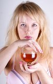 image of boose  - Girl with glass of cognac on white background - JPG