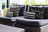 Black, White Cushion And Pillow On Wicker Chair poster