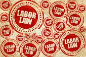 labor law, red stamp on a grunge paper texture poster