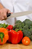 foto of cutting board  - assorted fresh vegetables on cutting board with chefs  - JPG