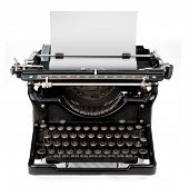 picture of old vintage typewriter  - old fashioned vintage typewriter isolated on white background with a blank sheet of paper inserted - JPG