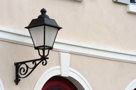 pic of lamp post  - retro style lamp post on a house in the street - JPG