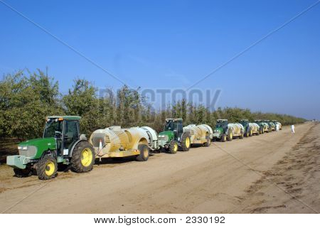 Tractors And Insecticide Spraying Trailers