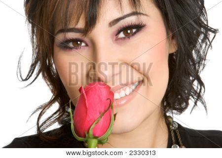 Beautiful Girl Smelling Rose