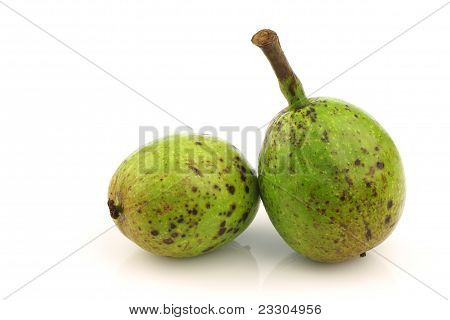 two fresh walnuts (Juglans regia)