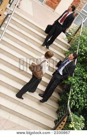 Business Team On Stairway,Leaving Building