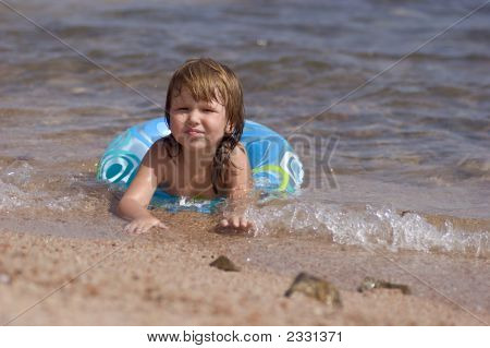 Kid Lying On The Shore