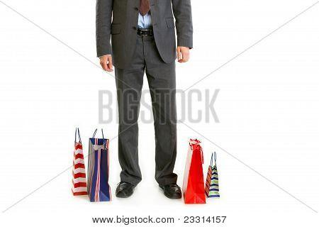 Shopping Bags Near Businessman Legs