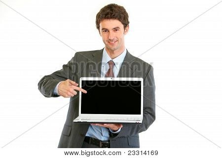 Modern Businessman Pointing On Laptops Blank Screen