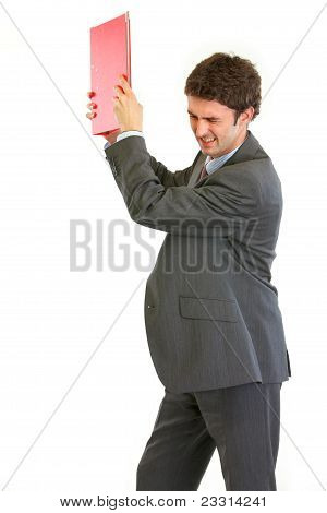 Angry Businessman Throwing Folder
