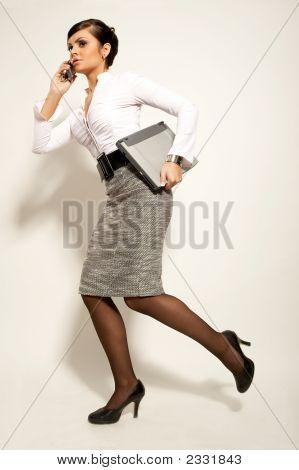 Running Atractive Brunet Businesswoman