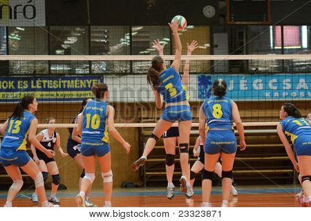 KAPOSVAR, HUNGARY - APRIL 24: Zsofia Harmath (blue 3) in action at the Hungarian NB I. League woman volleyball game Kaposvar (blue) vs Ujbuda (black), April 24, 2011 in Kaposvar, Hungary.