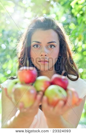 adorable young girl with sappy apples