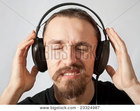 Young Man In Headphones With Eyes Closed