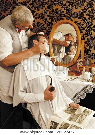 Victorian barber shaving a customer (the antique magazine is from 1910).