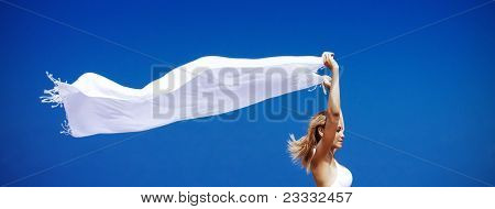 Female Enjoying Wind Over Sky