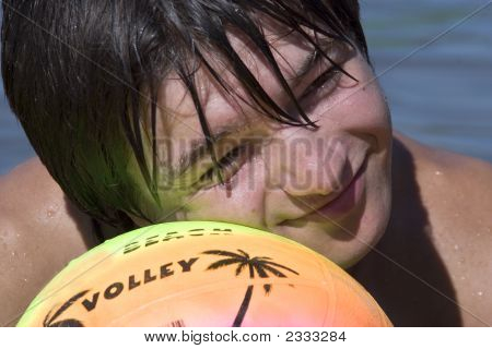 Teenager With Ball On The Beach