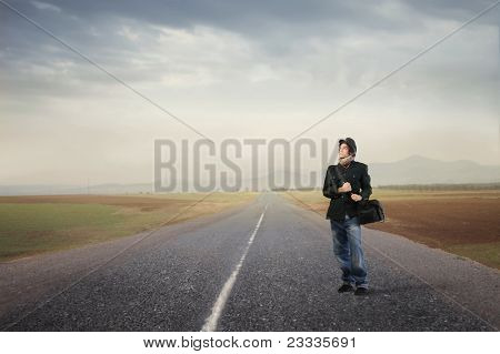 Young man standing on a countryside road