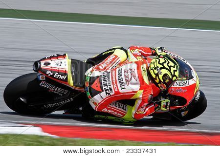 SEPANG, MALAYSIA - FEBRUARY 2: MotoGP rider Valentino Rossi of the Ducati Malboro Team practices at the 2011 MotoGP winter tests at the Sepang International Circuit. February 2, 2011 in Malaysia