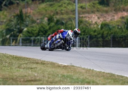 SEPANG, MALAYSIA - FEBRUARY 22: MotoGP rider Jorge Lorenzo of Yamaha Factory Racing team practices at the 2011 MotoGP winter tests at the Sepang International Circuit on February 22, 2011 in Sepang, Malaysia