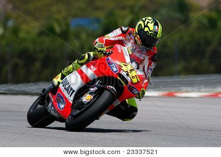SEPANG, MALAYSIA - FEBRUARY 22: MotoGP rider Valentino Rossi of the Ducati Malboro Team practices at the 2011 MotoGP winter tests at the Sepang International Circuit on February 22, 2011 in Sepang, Malaysia