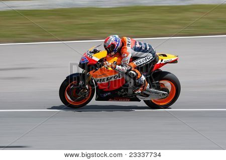 SEPANG, MALAYSIA - FEBRUARY 23: MotoGP rider Casey Stoner of the Repsol Honda Team practices at the 2011 MotoGP winter tests at the Sepang International Circuit. February 23, 2011 in Malaysia.