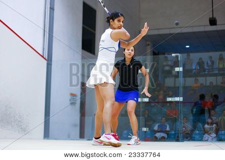 BK JALIL, MALAYSIA - MARCH 16: Delia Arnold (Malaysia) in black takes on Joshna Chinappa (India) at the CIMB KL Open Squash Championship 2011 at the National Squash Centre. March 16, 2011 in Malaysia.