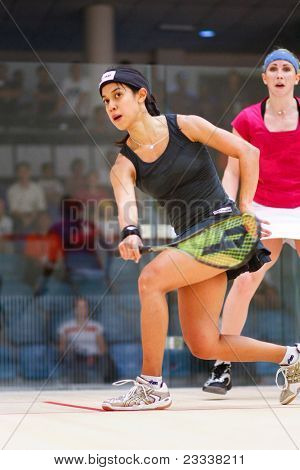 B.JALIL, MALAYSIA - MARCH 17: World champion Nicol David (black) plays Sarah Kippax (England) at the CIMB KL Open Squash Championship 2011 at the National Squash Centre on March 17, 2011 in B.Jalil, Malaysia.
