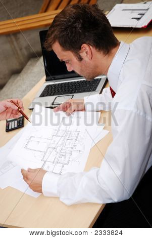 Male Architect Working With Blueprints