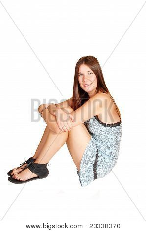 Girl Sitting On Floor.