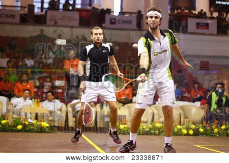 KUALA LUMPUR, MALAYSIA - MARCH 19: Top see Karim Darwish, Egypt (white) plays Gregoire Marche, France at the semifinals of the CIMB KL Open Championship 2011 on March 19, 2011 Kuala Lumpur, Malaysia.