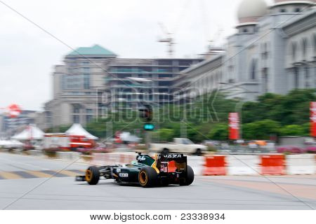 PUTRAJAYA, MALAYSIA - APRIL 2: Heikki Kovalainen of Team Lotus drives on the streets of Putrajaya in the F1 Street Demo promoting the Petronas Malaysian Grand Prix. April 2, 2011 Putrajaya, Malaysia.