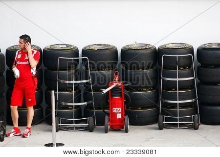 SEPANG, MALAYSIA - APRIL 8: Scuderia Ferrari F1 pit crew prepares the tires for the practice and qualifying runs of the Petronas Malaysian F1 Grand Prix on April 8, 2011 Sepang, Malaysia.