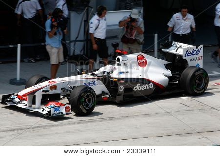 SEPANG, MALAYSIA - APRIL 8: Kamui Kobayashi of the Sauber F1 team leaves the pit for a practice run on the first day of the Petronas Malaysian F1 Grand Prix on April 8, 2011 Sepang, Malaysia.